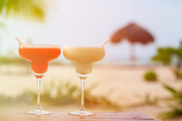 Two cocktails on tropical sand beach