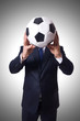 Businessman with football on white