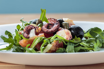 Octopus salad with rucola and olives