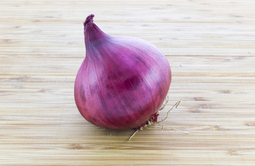 A whole red onion