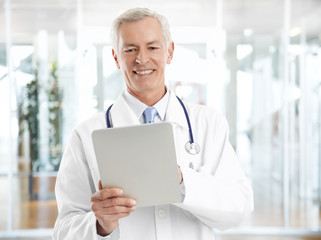 Portrait of a male doctor with digital tablet