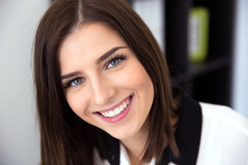Closeup image of a cheerful young woman