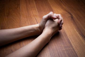 Image of praying woman hands