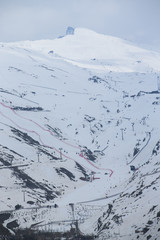 Winter landscape on mountain with ski lift and ski slope.