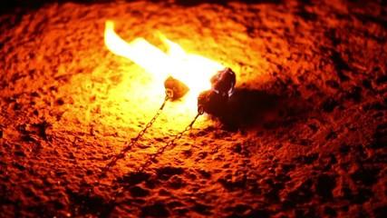 Poi burning on the ground