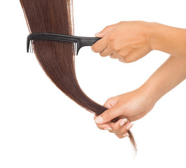 hands combing her hair on white background