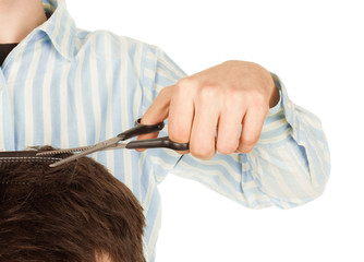 barber scissors in hand on white