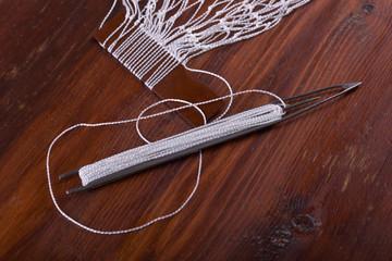 Shuttle for tying fishing nets