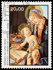 Stamp printed in Guinea-Bissau shows Virgin and Child by Bottice