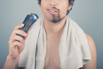 Man with broken razor cannot finish shaving
