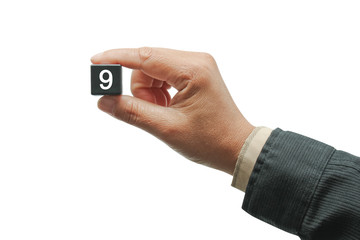Hand with number.