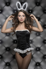 erotic brunette girl with bunny ears