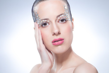 Beautiful girl with diamonds on face