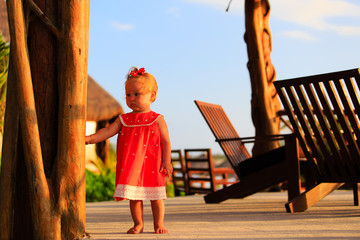 cute little girl walking in tropical resort