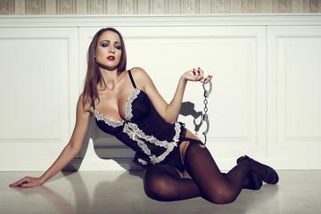 Sensual woman holding handcuffs