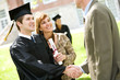 Graduation: Mother Stands By Son with Pride