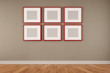 Sechs rote Rahmen an einer Wand