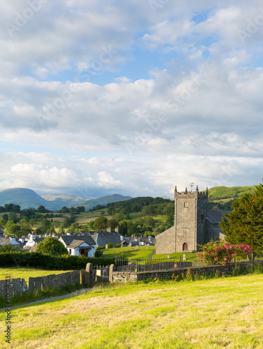 Leinwandbild Motiv Hawkshead Lake District village and church uk