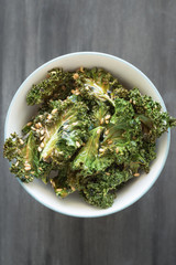 Homemade Curly Kale Chips Sprinkled with Flax Seeds