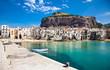 Leinwandbild Motiv Beautiful old harbor with wooden fishing boat in Cefalu, Sicily