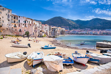 Wooden fishing boats on the old beach of Cefalu, Sicily