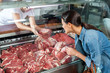 Woman Buying Fresh Red Meat - 80015419