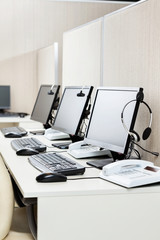 Computers With Headphones At Office