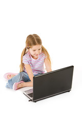 Computer: Young Girl Uses Laptop Computer