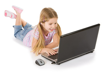 Computer: Young Girl Laying Down With Laptop