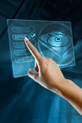 a finger choice to repair a hard disk on a digital screen