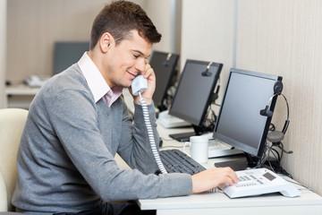 Call Center Employee Using Landline Phone