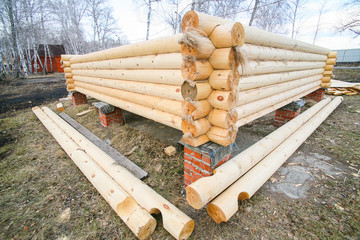 house under construction from pine logs