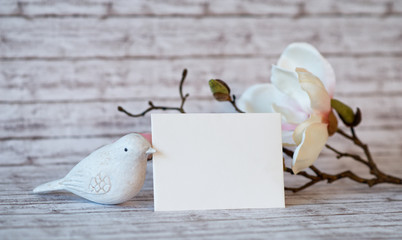 Bird Figurine and Blank Card with White Blossoms