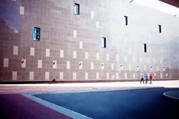 high-tech wall, three people goes away
