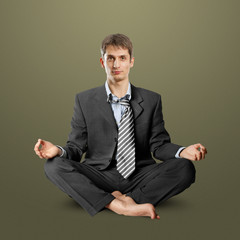 businessman in lotus pose