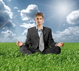 businessman in lotus pose outdoors