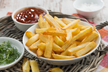 fried french fries with tomato sauce and herbs