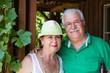 Happy trendy retired senior couple