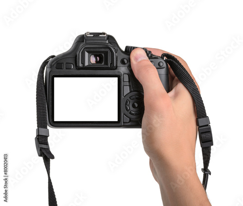 DSLR camera in hand isolated - 80020413