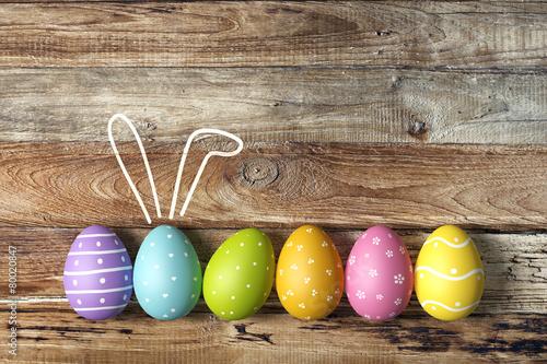 Leinwandbild Motiv Osterkarte mit bunten Ostereiern