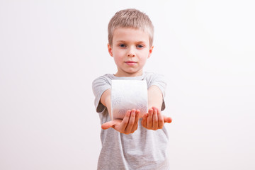 Young boy with a toilet paper
