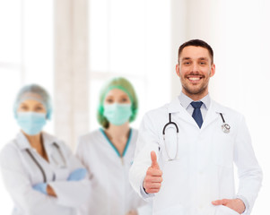 smiling doctor with stethoscope showing thumbs up