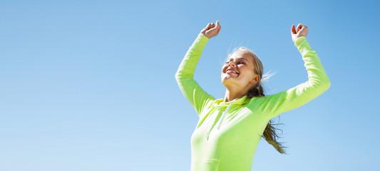 woman runner celebrating victory