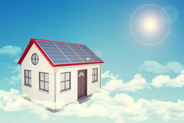 White house with red roof, solar panels in cloud. Background sun