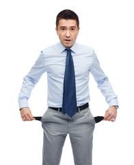 surprised businessman showing empty pockets