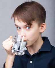 Kid drinks water