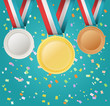 set of medals on confetti background