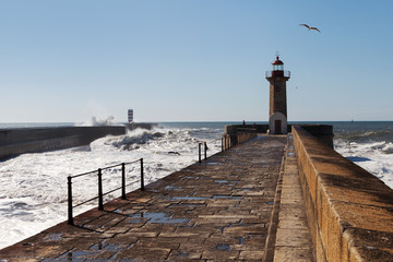 Waves on brekwater in Porto, Portugal.