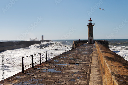 Waves on brekwater in Porto, Portugal. - 80022828