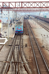 Passenger train standing on the station platform,
